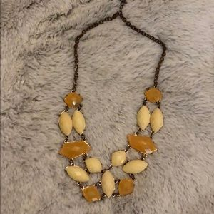 White, tan, and bronze colored gem necklace